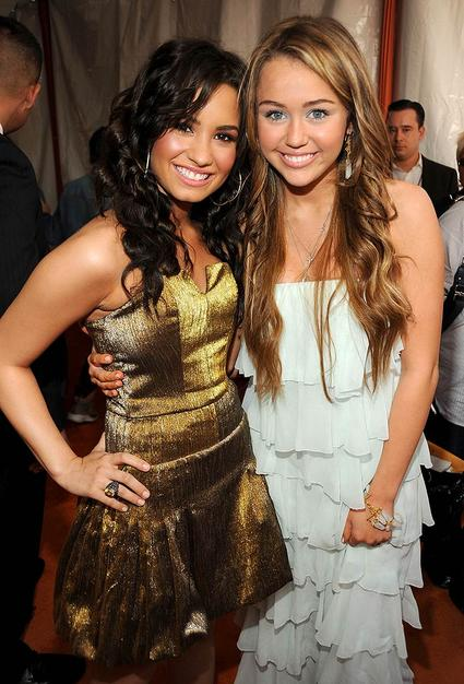 Although they were rumored to be feuding last summer, Demi and Miley played nice in front of the cameras.