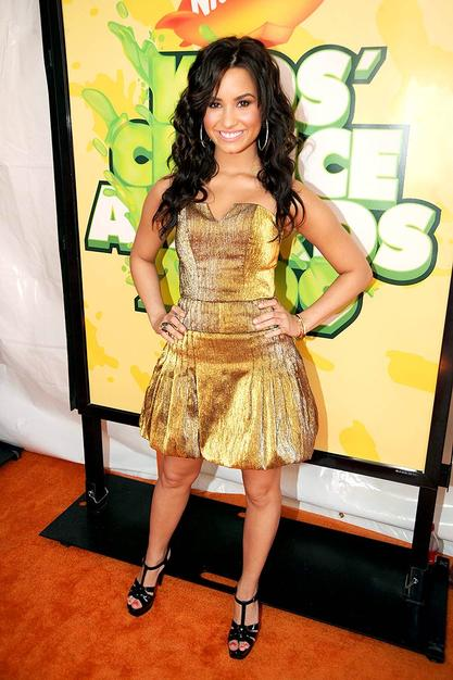After the Kids' Choice Awards, Demi Lovato's strapless golden dress will be perfect for prom!