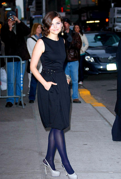 """Big Love"" looker Ginnifer Goodwin popped a pose outside of NYC's Ed Sullivan theater in dove gray Yves St. Laurent ""Trib Two"" slingbacks, a YSL LBD, and ravishing Roxanne Assounlin for Brian Reyes jewels."