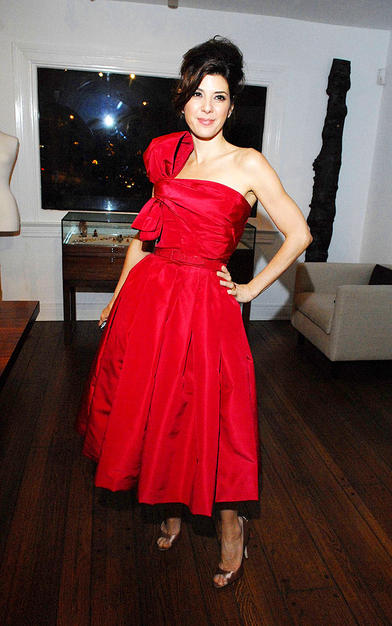 Red taffeta belted Christian Dior by Yves Saint Laurent dress and Brian Atwood heels worn by Marisa Tomei at last week's K. Brunini jewelry viewing party.