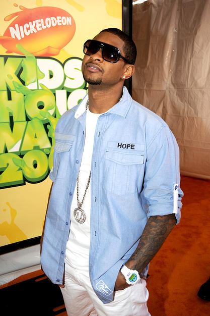 "Usher showed his support for President Obama when he struck a pose on the orange carpet in this ""Hope"" button-down shirt."