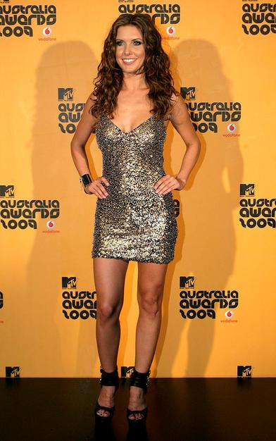 "MTV's Australia Awards were hosted by ""Hills"" hottie Audrina Patridge, who stole the spotlight in a sparkling gold paillette-covered Alberto Makali mini."