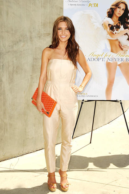 """Hills"" hottie Audrina Patridge also experimented with the jumpsuit trend by pairing her pale one-piece with strappy platform wedges, sun-kissed tresses, and a tantalizing tangerine clutch."