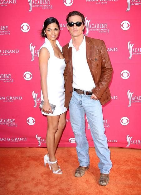 Camila Alves sported a collared white mini and cute heels, while her main squeeze Matthew McConaughey opted for a white shirt, leather jacket, jeans, and busted boots.