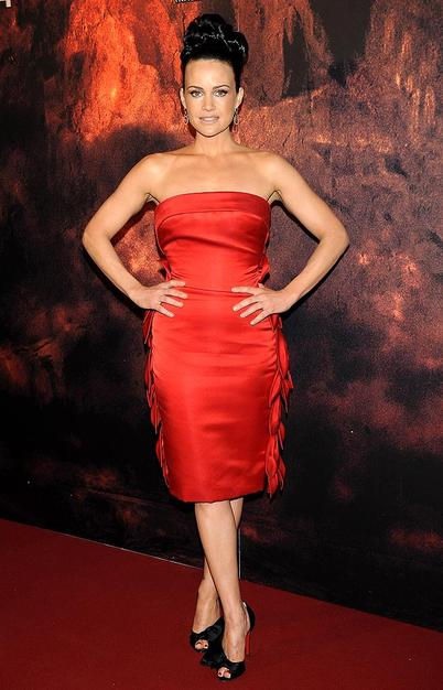 "Carla Gugino lit up the arrivals line at the Madrid premiere of ""Race to Witch Mountain"" in a fire engine red Georges Chakra frock and $895 Christian Louboutin ""Bow T Dorcet"""