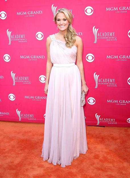 Carrie Underwood arrived at the 44th annual Academy of Country Music Awards in Las Vegas in a gorgeous goddess gown -- the first of several looks the singer wore throughout the evening. Underwood was named entertainer of the year - the first female act to win the award since the Dixie Chicks did back in 2000.