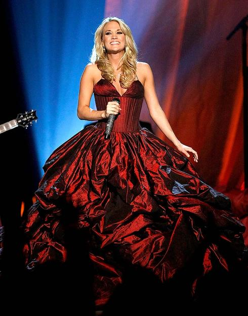 Carrie Underwood caused a commotion at the 44th Annual Academy of Country Music Awards in a billowing burgundy beauty, courtesy of Rafael Cennamo.