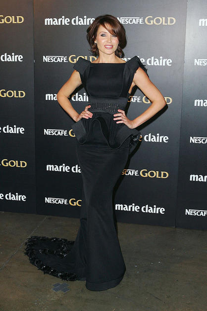 Kylie Minogue's lil sis Dannii popped a pose at the 2009 Prix de Marie Clarie Awards at Sydney's Royal Hall of Industries in a fabulously futuristic J'Aton Couture gown, complete with a crystal-embellished train.