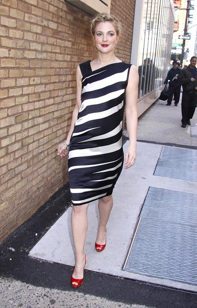 "Drew Barrymore looked better than ever as she left a taping of ""Live with Regis and Kelly"" in this black-and-white striped Narcisco Rodriguez asymmetrical dress, braided updo, ruby red lips, and matching $550 Miu Miu ""Whipstitch"" slingbacks."