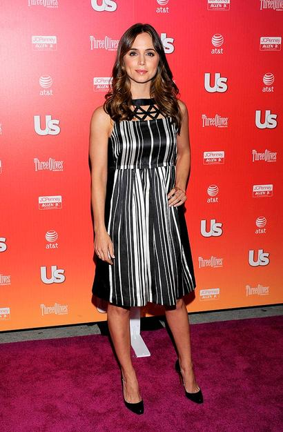 """Dollhouse"" star Eliza Dushku was much more subdued in a striped cocktail frock."