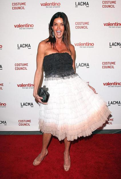 "The self-proclaimed ""world's first supermodel"" Janice Dickinson livens up the arrivals line in ruffled, multi-colored cocktail frock."