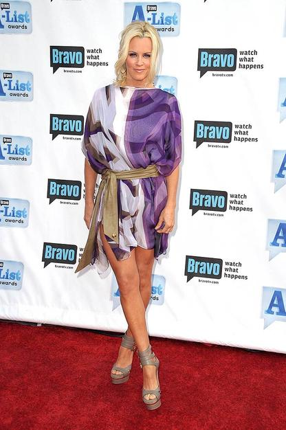 Jenny McCarthy accentuated her fabulous gams in a purple print frock and strappy platform sandals.