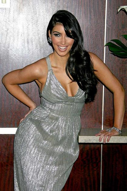 Kim Kardashian flaunts her curves for a Genlux magazine shoot at the Luxe Hotel in Beverly Hills, California.