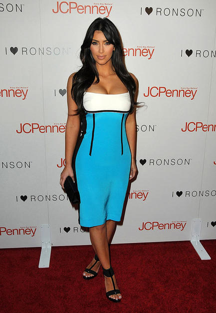 "The stunning Kim Kardashian wowed the crowd in an electric blue-and-white dress and black strappy sandals at the ""I Heart Ronson"" dinner party at Bar Marmont."