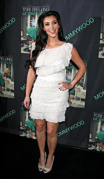 "Kim Kardashian continued to impress at Tori Spelling's ""Mommywood"" book signing in a ruffled white cocktail dress and cute peep toes."