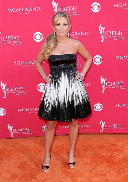 Lee Ann Womack didn't seem thrilled with her decision to don this sparkling black and white strapless frock, and neither were we.