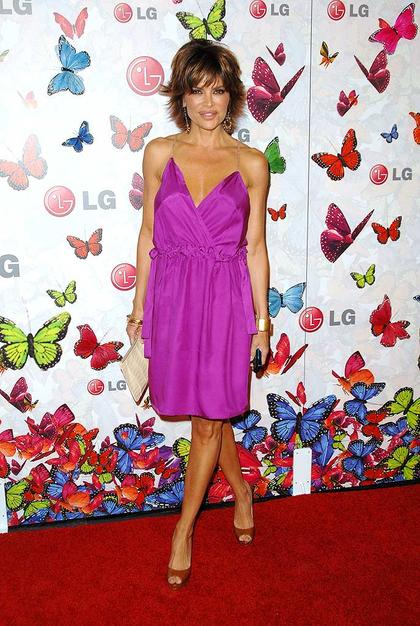 Lisa Rinna, who recently bared all in Playboy at the age of 45, showed off her fab figure in a fuchsia frock.