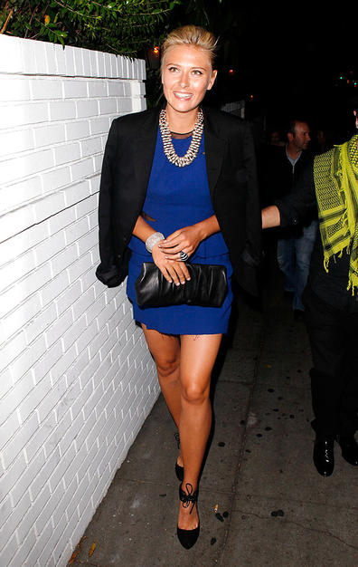 Tennis ace Maria Sharapova showed some leg and a lot of bling as she sashayed to a Cole Haan dinner in a blue Thakoon mini, black strappy heels, silver Dries van Noten statement necklace, and her signature smile.