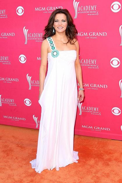 Martina McBride was a vision in white thanks to her single-shouldered Badgley Mischka gown, which was embellished with turquoise beads.