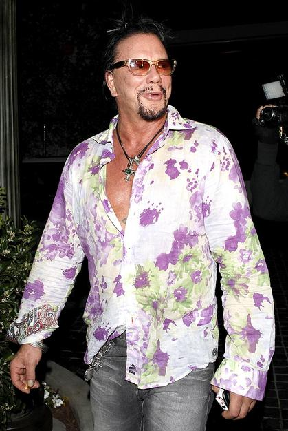 Who says only women can wear floral prints? Mickey Rourke rocked this blooming button-down for a night on the town.