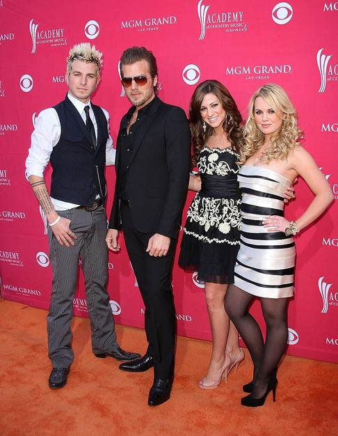 Gloriana's Mike Gossin, Tom Gossin, Rachel Reinert and Cheyenne Kimball struck poses in their stylish ensembles before entering the star-studded event.