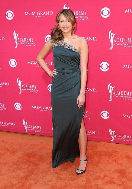 Miley Cyrus dressed to impress in a bedazzled Monique Lhuillier floor-length dress and strappy heels.