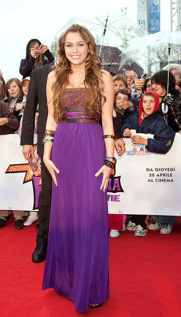 """Miley Cyrus continued to rock the red carpet at yet another """"Hannah Montana"""" movie premiere in multi-colored Kara Ross bangles and a purple strapless masterpiece, courtesy of Missoni."""