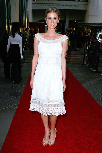 Nicky Hilton fails to impress in a gauzy grandma getup and nude peep toes.