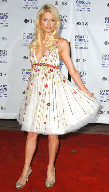 Small rosettes added pops of color to Paris Hilton's white dress.