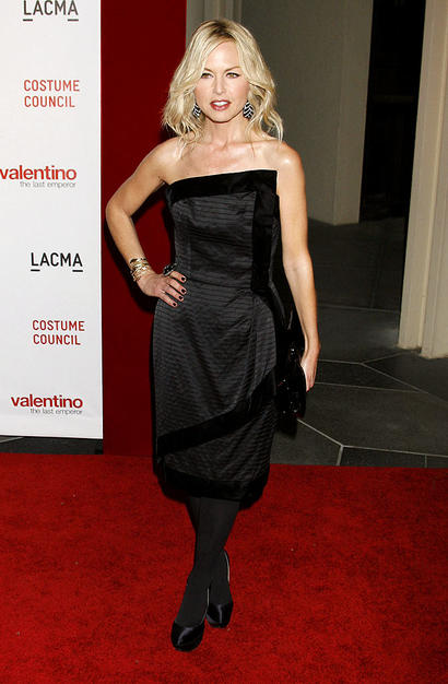 Style guru Rachel Zoe sports a strapless asymmetrical dress along with sexy satin Casadei pumps.