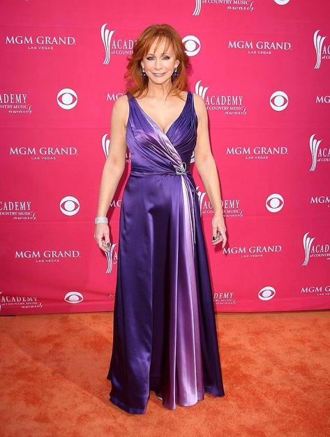The legendary Reba McEntire played it safe in a low-cut purple satin frock.