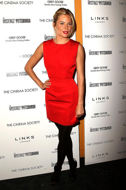 "Sienna Miller popped a pose upon arriving at a screening of ""The Mysteries of Pittsburgh"" in a scarlet shift, courtesy of Marios Schwab, black tights, and Roger Vivier heels."