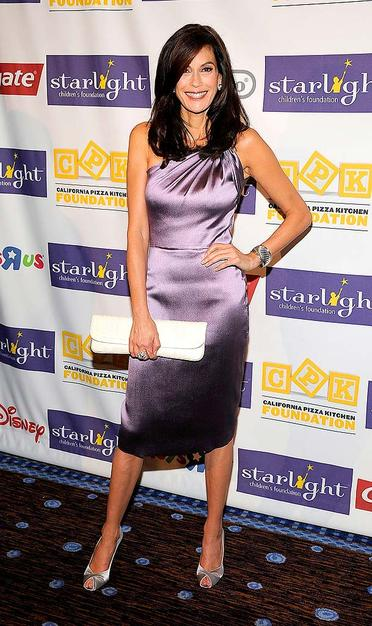 "Teri Hatcher looked far from ""desperate"" as she popped a pose in a sexy purple dress and metallic peep toes at Starlight Foundation's ""A Stellar Night"" gala."