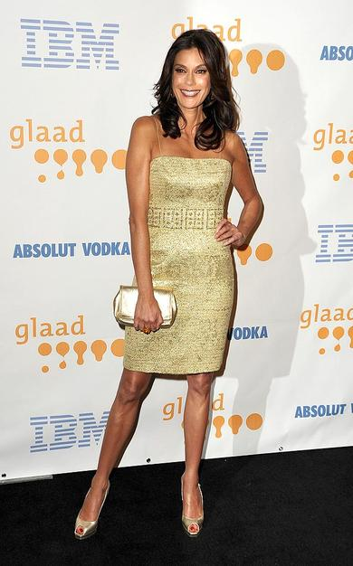 """Also in attendance ... """"Desperate Housewives"""" hottie Teri Hatcher, who glittered in an $800 gold tweed spaghetti-strapped Marchesa cocktail frock and metallic peep toes."""