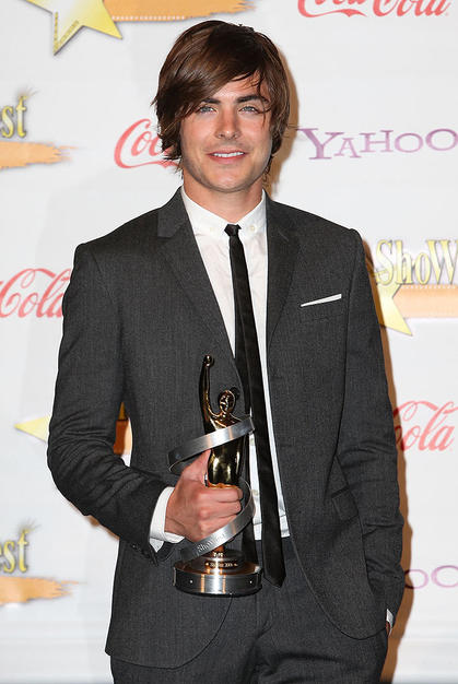 "Zac Efron was all smiles after winning the Breakthrough Performer of the Year Award at ShoWest on Tuesday. The ""HSM"" alum told Us Magazine he dropped out of the ""Footloose"" remake because he was ""looking for a new challenge, and this was another musical."""