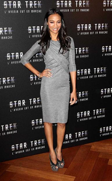 "Zoe Saldana was all smiles upon arriving at a Parisian press conference for ""Star Trek"" in a sophisticated 3/4 length sleeved dress and sassy black-trimmed peep toes."