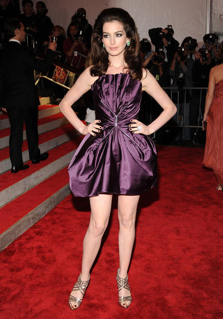 Anne Hathaway stood out in her purple poofed Marc Jacobs frock, retro bouffant 'do, and silver sandals.