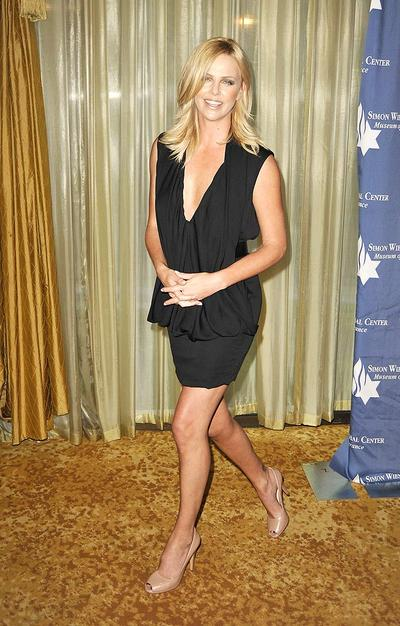 Charlize Theron shows off her gorgeous gams upon arriving at a charity dinner at the Beverly Wilshire Hotel in Beverly Hills, CA.