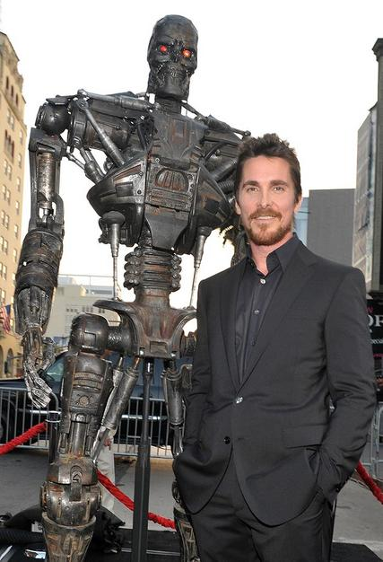 "Christian Bale was all smiles at the premiere of ""Terminator Salvation"" on Tuesday. McG, the film's director, said he was to blame for the actor's now infamous on-set tirade. ""We were making effectively a war scene, and I wanted the blood up of all my actors,"" McG explained to ""Access Hollywood."" ""Everybody was very wound up and everybody was fired up and I wanted him [Bale] that way ... I riled him up!"""