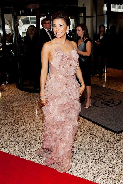 Eva Longoria Parker was tickled pink in this ruffled Ports 1961 creation.