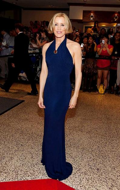 """Eva's """"Desperate Housewives"""" costar Felicity Huffman celebrated the right to bare arms in this navy halter dress."""