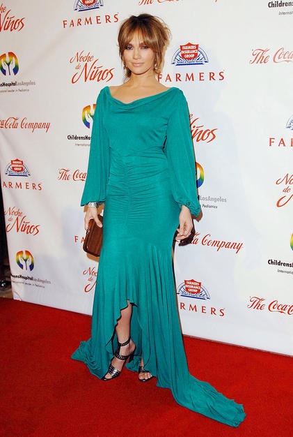 Jennifer Lopez and her sexy bedhead and muted makeup. Her teal jersey Temperley London gown, with blouson sleeves and a fishtail train really look good on her.
