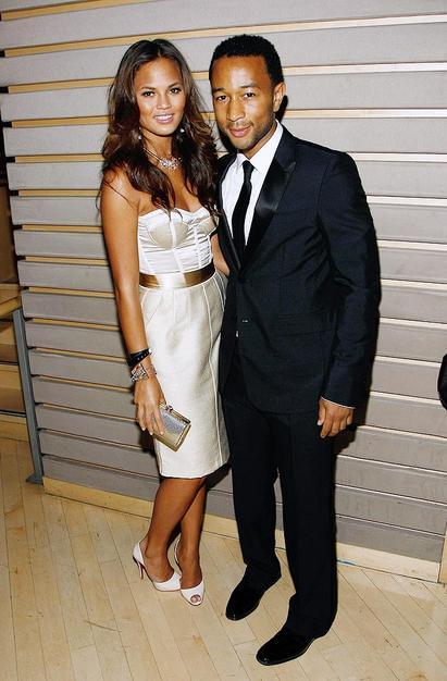 John Legend cozied up to his model girlfriend Christine Teigen.