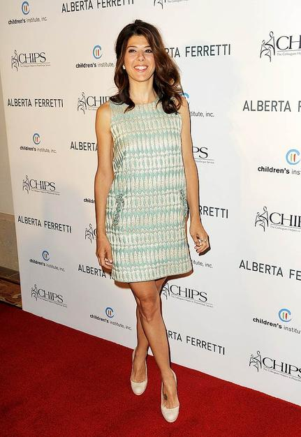 Marisa Tomei has been rocking the red carpet for months and continued to do so at a recent charity event in a turquoise-and-ivory pocketed frock and matching heels from Alberta Ferretti's latest line.