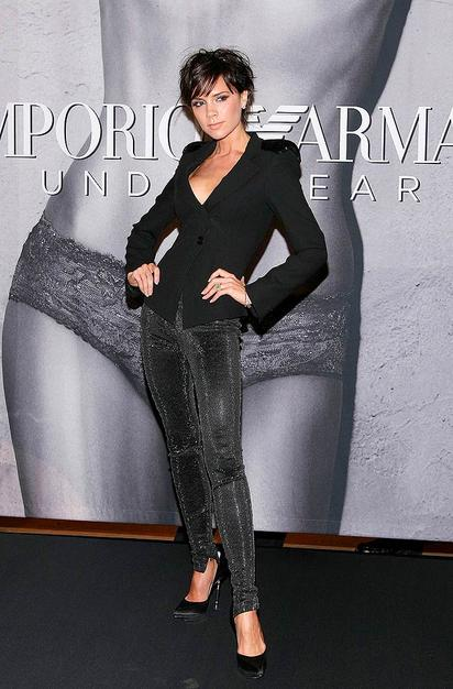 Victoria Beckham was sleek and chic in an updated 'do, sequined blazer, skin-tight trousers, and steel-heeled stilettos while promoting her posh Armani underwear ad campaign at Macy's Herald Square.
