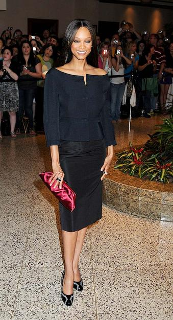Supermodel Tyra Banks also opted for sleek straight hair.