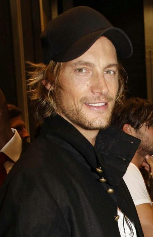 Gabriel Aubry is seen here backstage at a June 2009 Louis Vutton fashion show. He's one fine specimen.