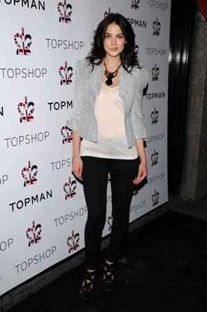 Ms. Michelle Monaghan punches up a casual outfit with funky, eclectic, chunky shoes.