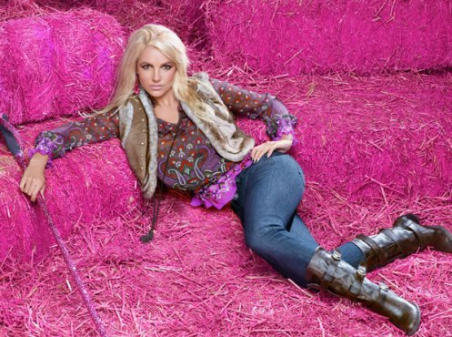Britney Spears poses for an ad for Candie's. She's lookin' pretty fly, whatever that means. That or Photoshopped.