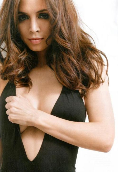 A picture of Eliza Dushku, who's featured in the new issue of FHM. Man this girl is hot stuff. Goodness, look at her.